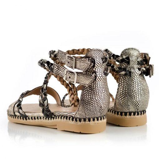 sandalias bajas de cuero trenzado negro y dorado
